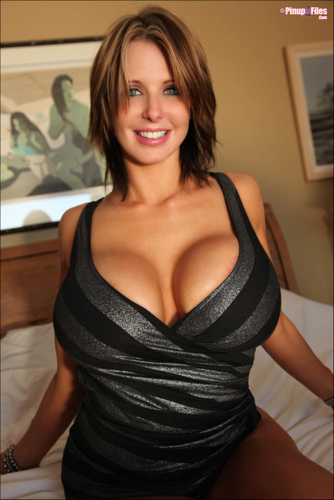 Brandy Robbins huge tits busting out of sexy low-cut dress ...