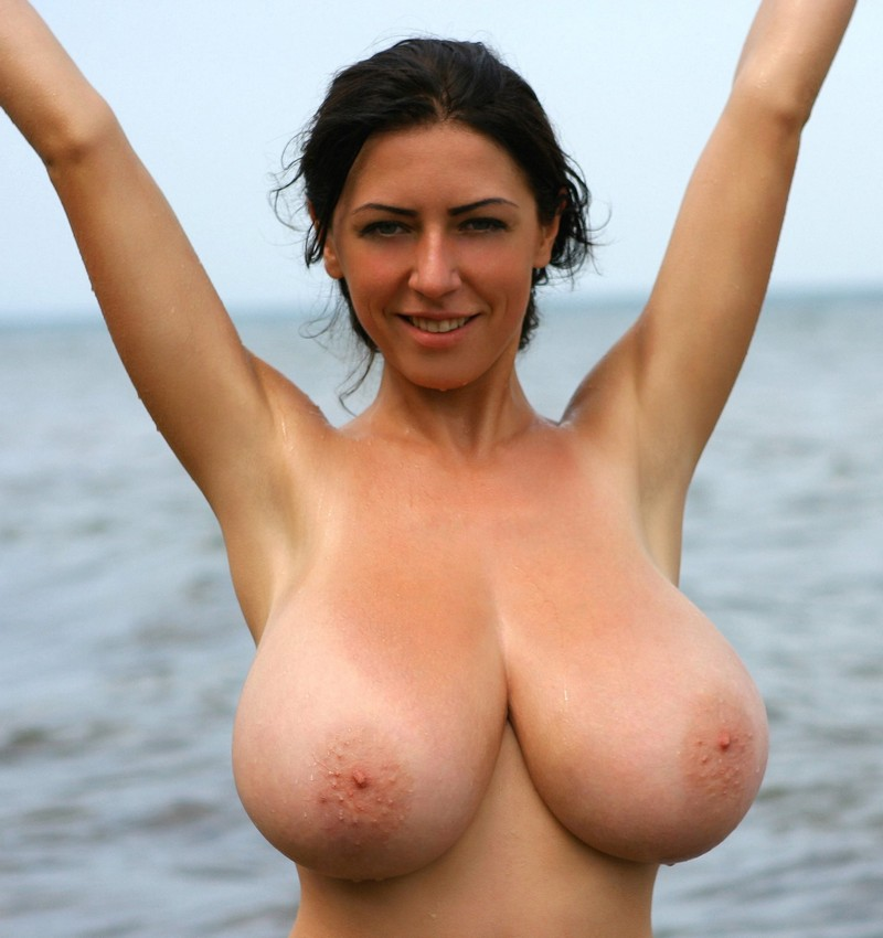 Natural boobs on the beach
